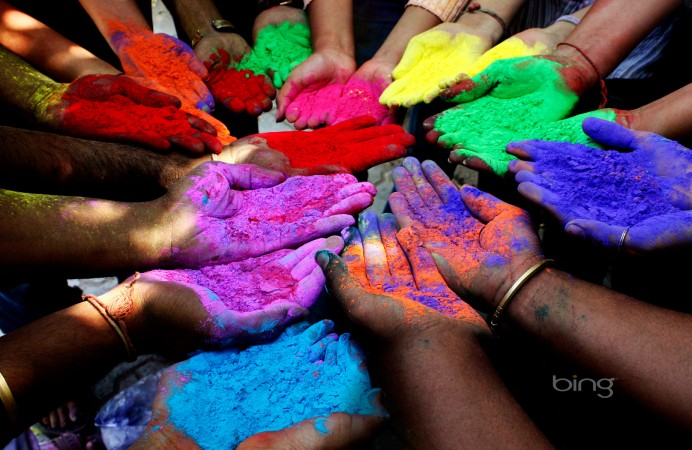 People holding powder paints to celebrate Holi (Festival of Colors) in Ahmedabad, India