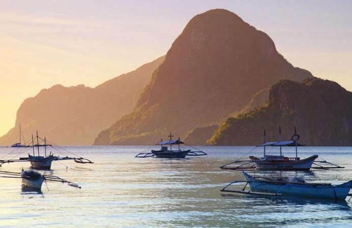 boats-el-nido-bay-palawan-philippines.rend_.tccom_.966.544-692x450