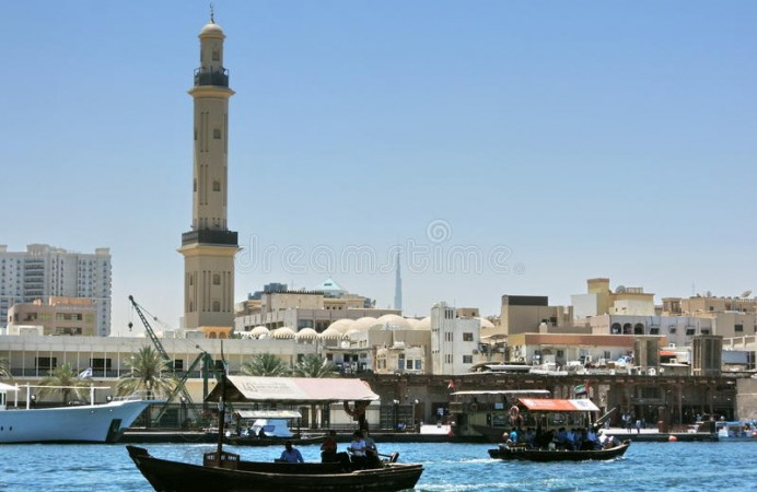 riverbank-dubai-creek-burj-khalifa-background-abra-boats-river-uae-united-arabic-emirates-66075171